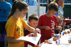 Pumpkin decorating at the resource fair.